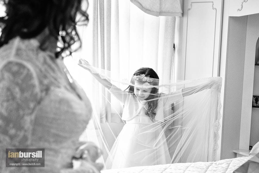 Bridesmaid with wedding dress veil