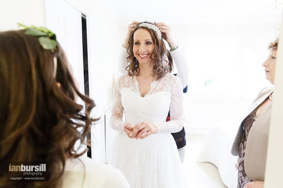 Bride having veil fitted
