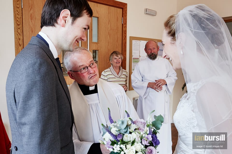 Prestwold Hall Wedding - The vicar gives his best wishes after the ceremony.