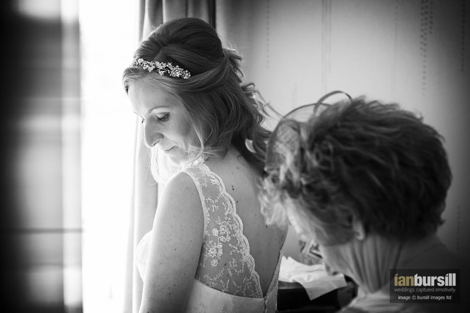 Joanne with her mum, sorting out the final touches on the dress.