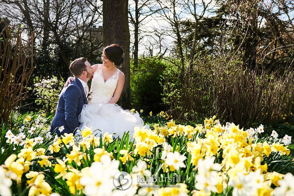 Bride & Groom at Prestwold Hall surrounded by Daffodils