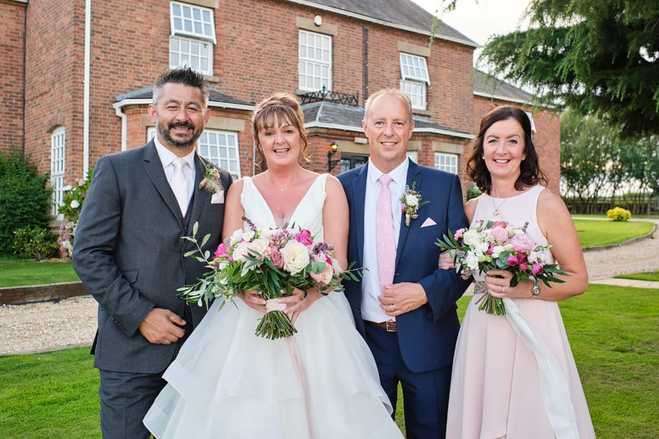 Bride and groom at Swancar Farm, Nottingham wedding with maid of honour