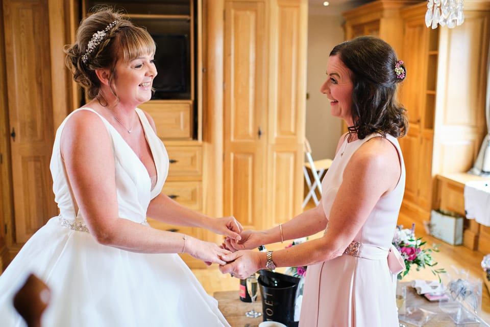 A lovely moment between Tonia & Emma at Tonia & George's Swancar Farm Wedding.