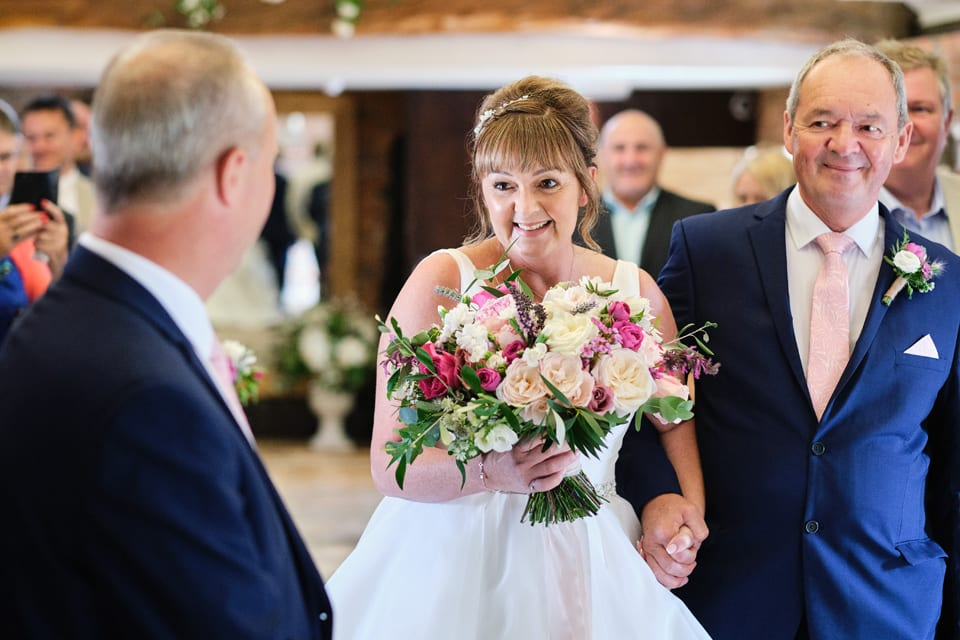 The arrival of the Bride. George & Tonia's Swancar Farm, Nottinghamshire Wedding. Flowers by Sassy Blooms, Leicestershire.