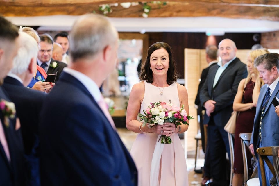 Maid of Honour Emma winking at George the Groom at Swancar Farm.