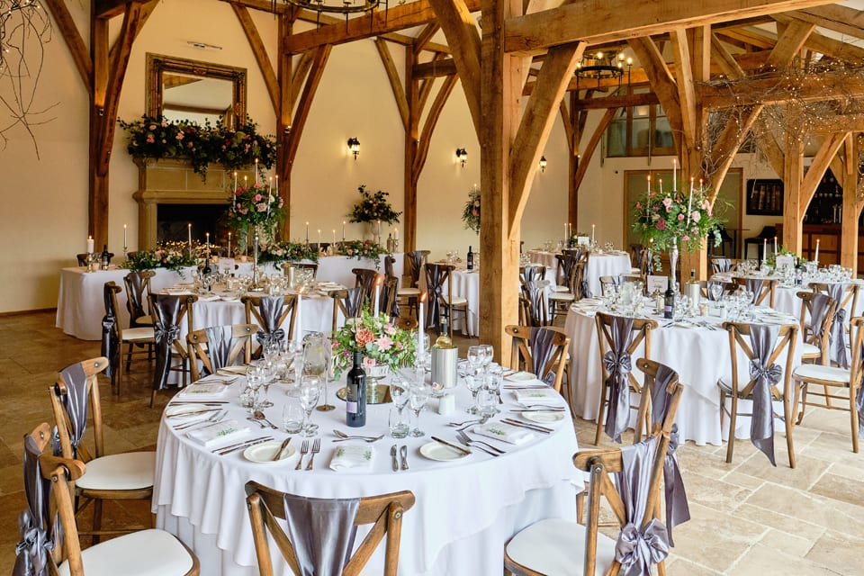 The dining room at George & Tonia's Swancar Farm, Nottinghamshire Wedding. Flowers by Sassy Blooms, Leicestershire.